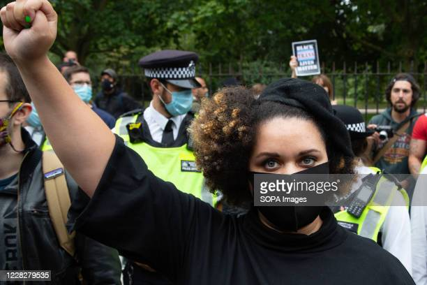 Woman holds up her fist during anti-racism protest. Organisers say the Million People march is intended to revive the original spirit of the...
