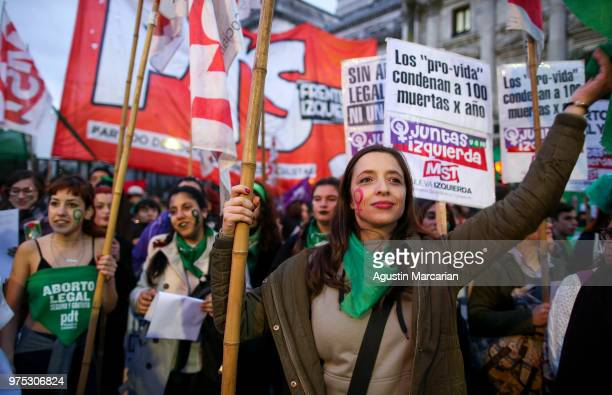 A woman holds up 'prolife' flags during a rally to demand legal and free abortion at Congressional Plaza on June 13 2018 in Buenos Aires Argentina A...