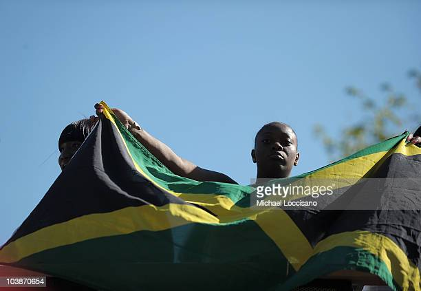 A woman holds up the flag of Jamaica during the West Indian American Day Parade on September 6 2010 in the Brooklyn borough of New York City The West...