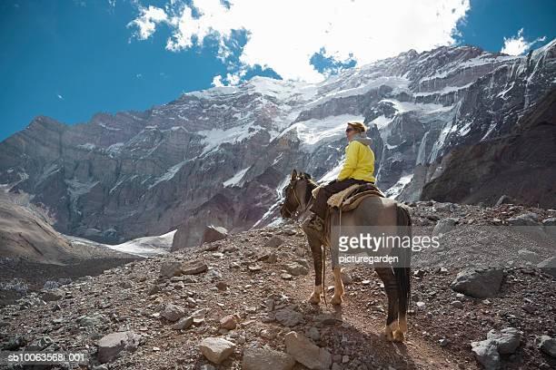 Woman horse trekking to Plaza Francia