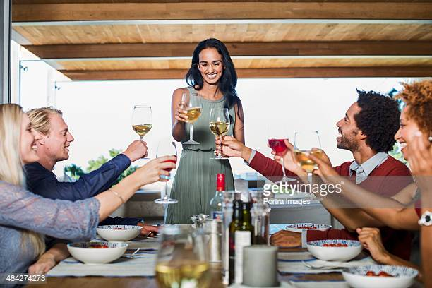 woman hosting a dinner party - party host stock pictures, royalty-free photos & images
