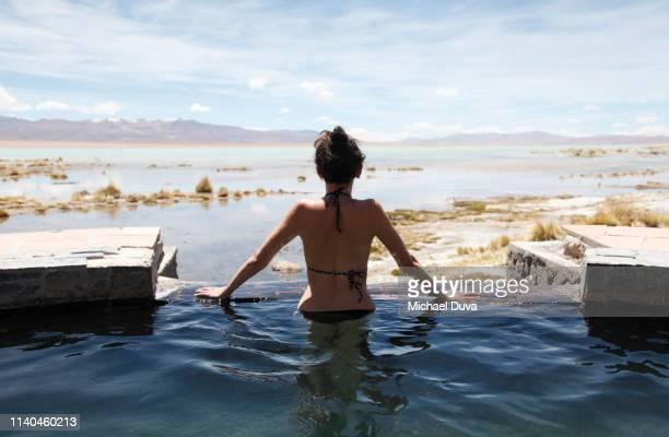 woman hot spring bathing in bikini - amerikanische kontinente und regionen stock-fotos und bilder