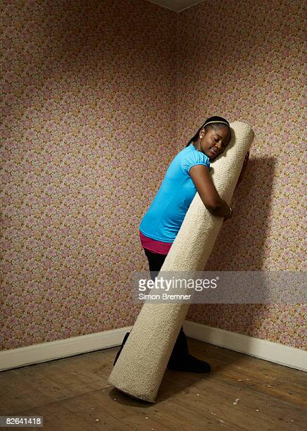 Woman hugging carpet