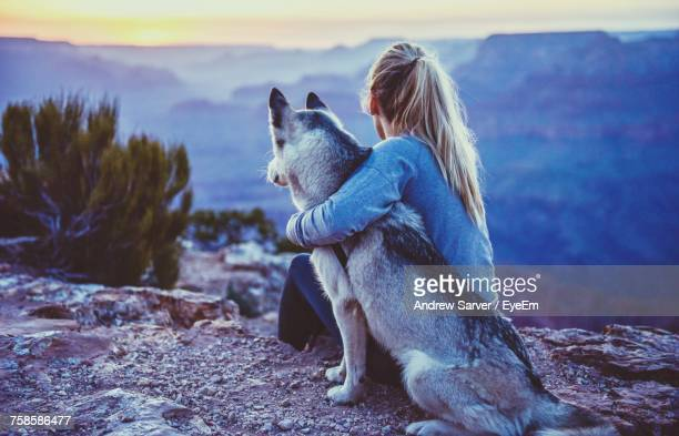 Woman Hugging Dog Outdoors