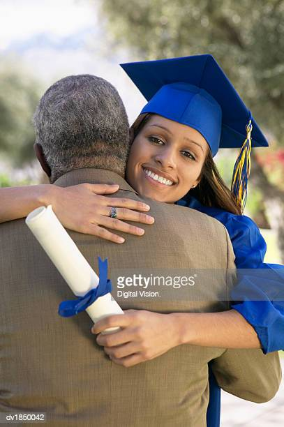 Woman Hugging Her Father at Graduation