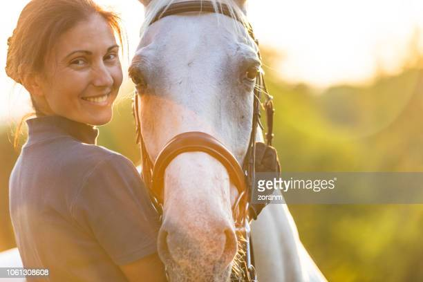 woman hugging her horse - horse stock pictures, royalty-free photos & images