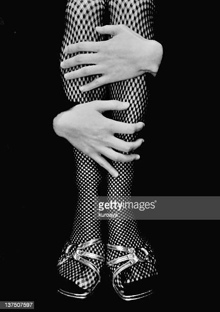 woman hugging knees - fishnet stockings stock pictures, royalty-free photos & images