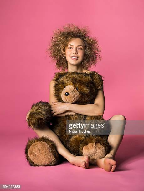 woman hugging large stuffed animal bear