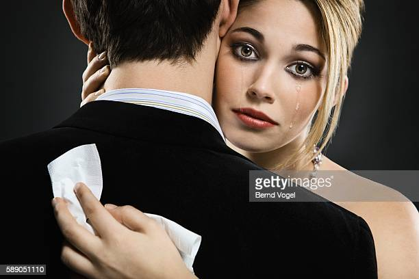 Woman hugging man and crying