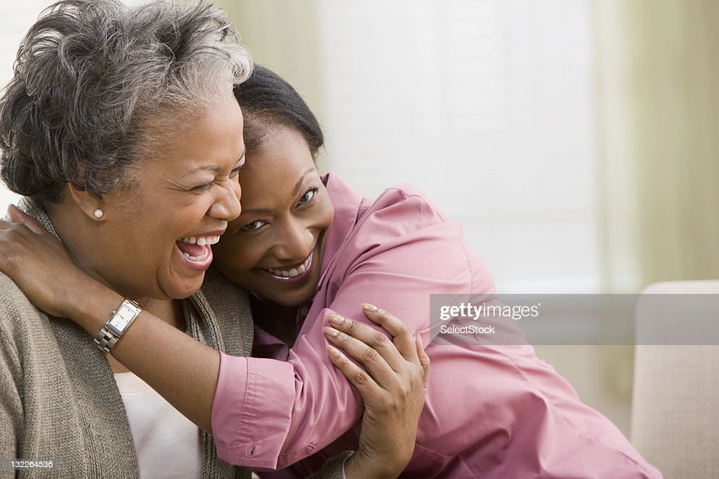Woman hugging mother : Stock Photo