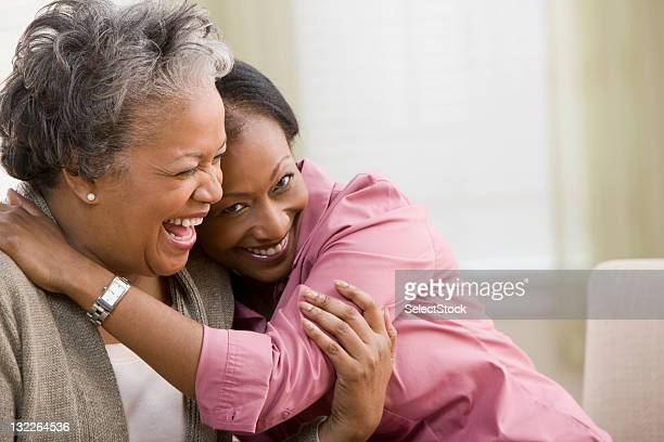woman hugging mother - mother daughter stock photos and pictures
