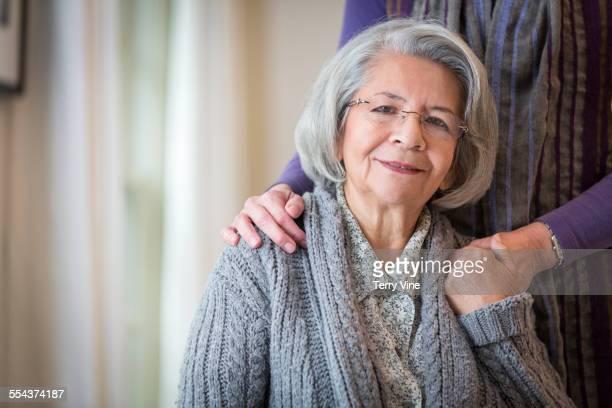 Woman hugging smiling mother