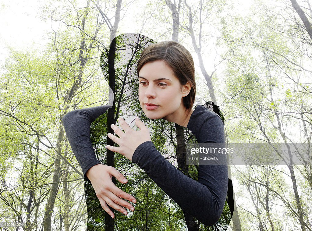Woman hugging the environment. : Stock Photo