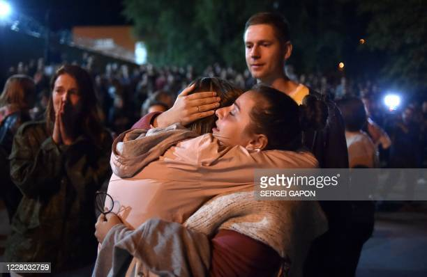 A woman hugs a relative released from the Okrestina prison and who was detained during recent rallies of opposition supporters who accuse strongman...