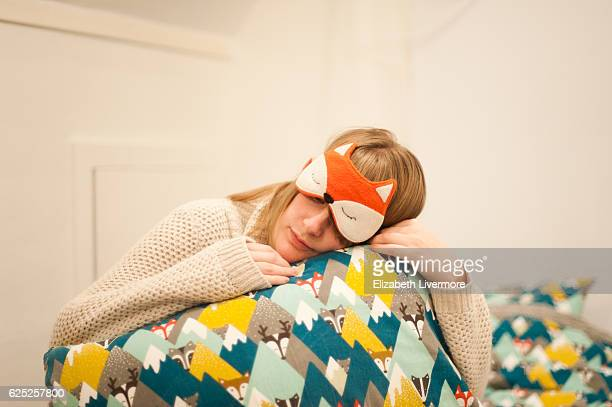 Woman hugs her pillow