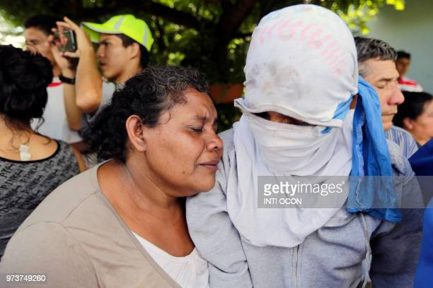 A woman hugs her son after he was relesead by police due to mediations of the Catholic Church and the Nicaraguan Association for Human Rights outside...