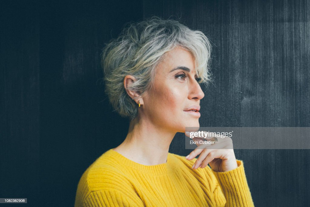 Ageless woman in contemplative mood : Stock-Foto