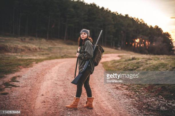 woman hunter, looking for birds - hunting stock pictures, royalty-free photos & images