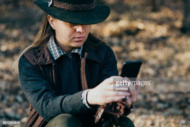 woman hunter using phone