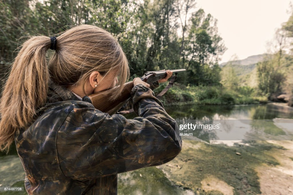 Woman hunting : Stock Photo