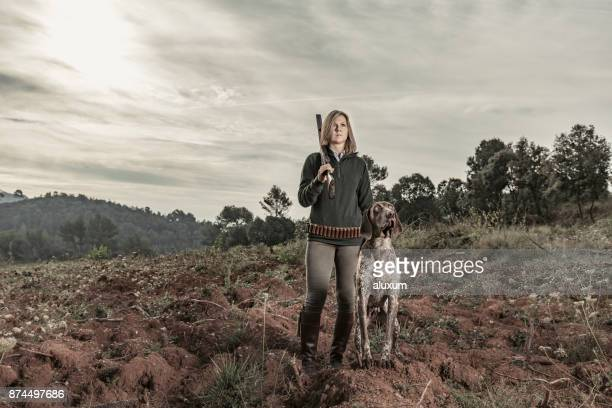 woman hunting with dog in spain - hunting dog stock pictures, royalty-free photos & images