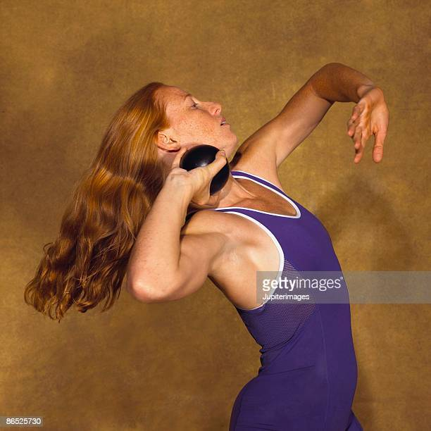 woman hurling shot up - shot put stock pictures, royalty-free photos & images