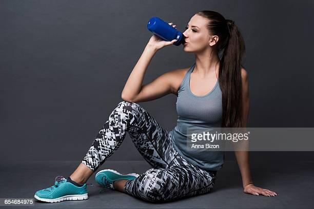 Woman hydrating after tiring training. Debica, Poland