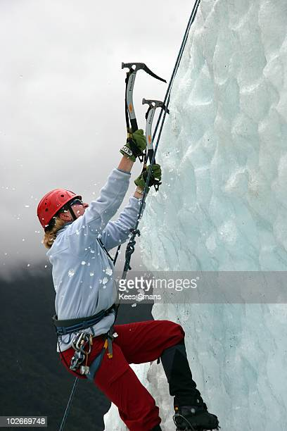 Woman ice climbing on Fox Glacier