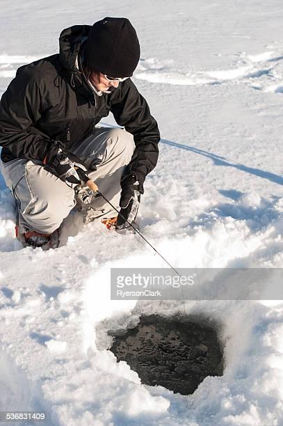 Woman Ice Fishing, Great Slave Lake, Yellowknife, Northwest Territories.