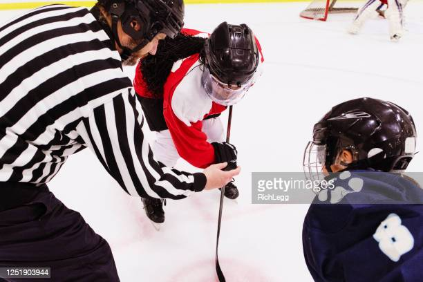 woman ice hockey team on the ice - face off stock pictures, royalty-free photos & images