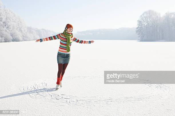 woman ice skating in circles - スケート靴 ストックフォトと画像