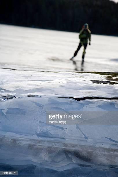 a woman ice skating on a frozen lake sweden. - dalsland - fotografias e filmes do acervo