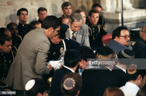 Woman identified as Eva Mozes Kor, of Terre Haute, Ind., is hustled from the scene by security personnel inside the Capitol Rotunda 5/6 during a...