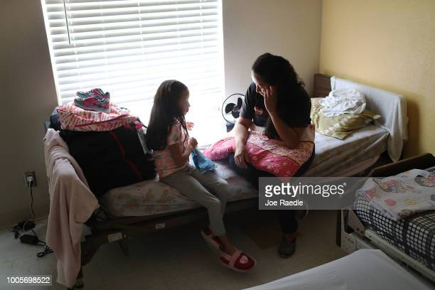 A woman identified only as Heydi and her daughter Mishel relax together in an Annunciation House facility after they were reunited on July 26 2018 in...
