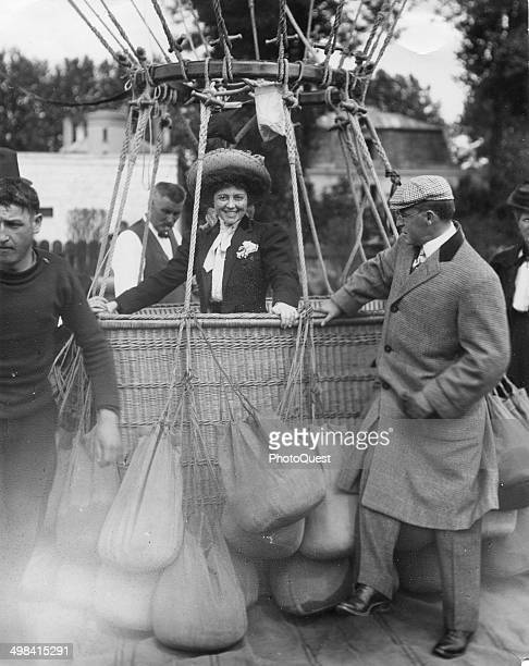 A woman identified only as Mademoiselle Lawbert smiles as she stands in the basket of a hotair balloon late 1890s or early 1900s