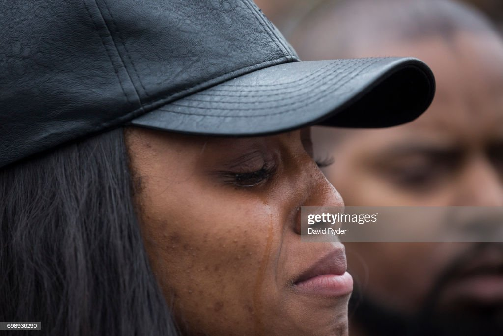 A woman identifying herself as a cousin of Charleena Lyles cries while speaking during a protest and rally in honor of Lyles on June 20, 2017 in Seattle, Washington. Officers from the Seattle Police Department shot and killed Lyles, a pregnant mother of four, on June 18.