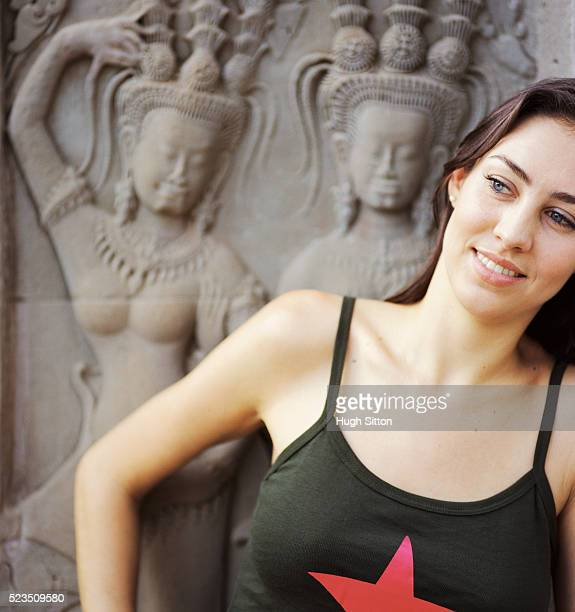 woman imitating temple carvings - hugh sitton stock pictures, royalty-free photos & images