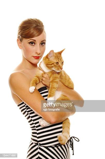 Woman in 60s look holding a cat