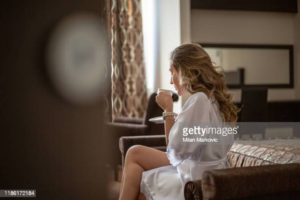 woman in a bathrobe enjoys the room - chesty love stock pictures, royalty-free photos & images