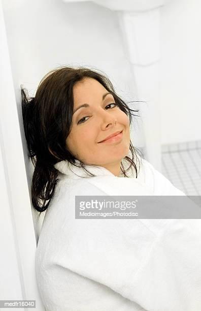 Woman in a bathrobe smiling