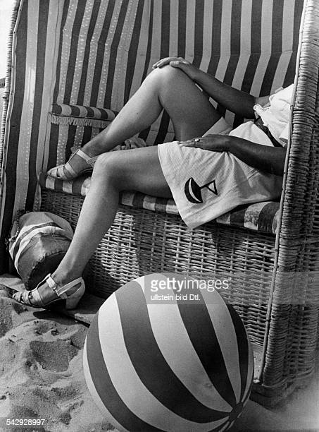 Woman in a beach chair May 1938 Published 1939