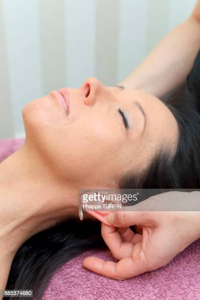 Woman in a beauty parlour.Ear massage