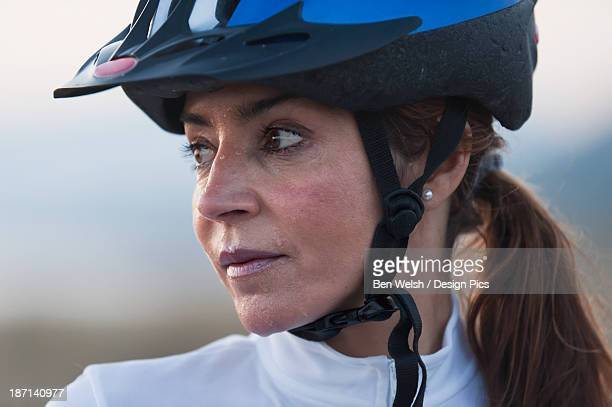 A Woman In A Bicycle Helmet Dripping With Sweat