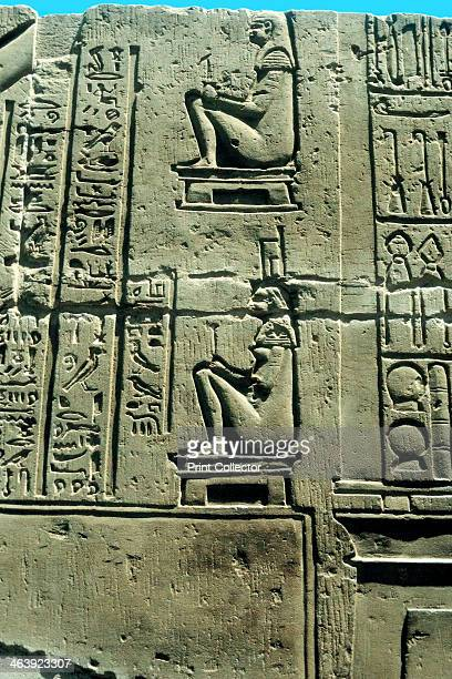 Woman in a birthing chair Ancient Egyptian limestone relief from Kawm Umbu Various medical instruments are depicted on the right
