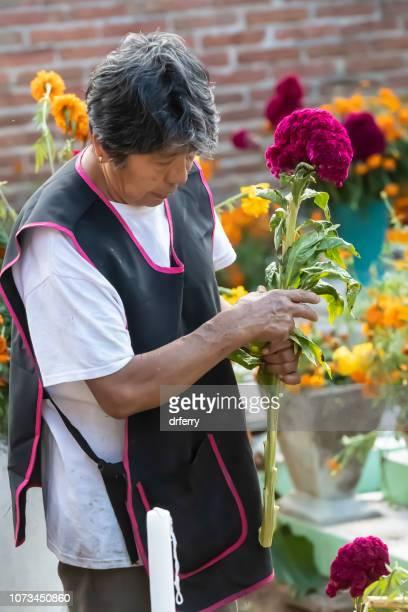 Femme dans un bandeau noir sur le Día de los Muertos, Oaxaca