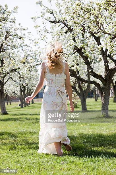 woman in a blossoming orchard
