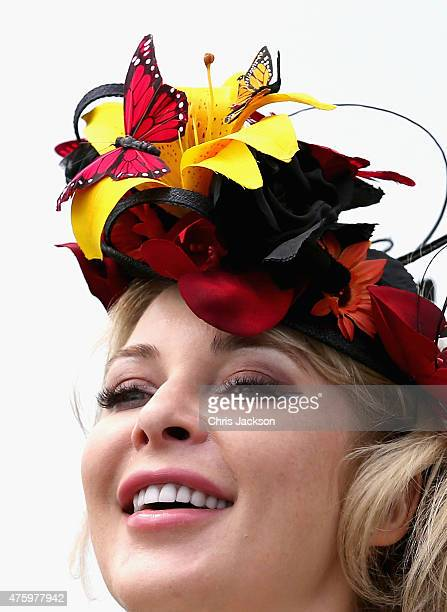 A woman in a butterfly hat watches the racing during Ladies Day at the Investec Derby Festival on June 5 2015 in Epsom England
