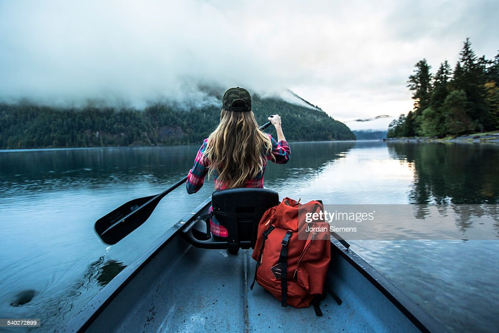 A woman in a canoe. : Stock Photo