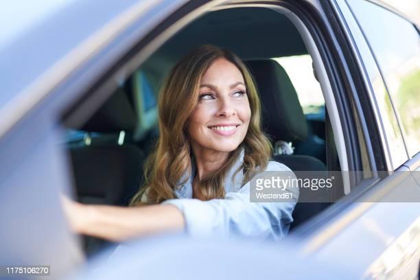 woman in a car - fahren stock-fotos und bilder