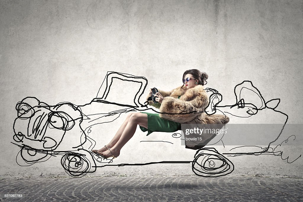 Woman in a car : Stock Photo